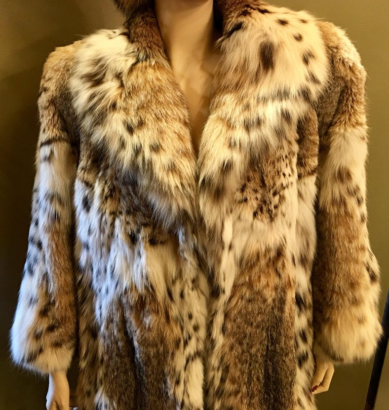 Gorgeous and very sexy, luxurious lynx coat is 3 quarter length of natural, ultra soft, spotted lynx fur with a large and stylish shawl collar.  Coat features 2 velvet lined slash pockets and closes with 3 hooks and eyes.  Lynx fur is distinctively