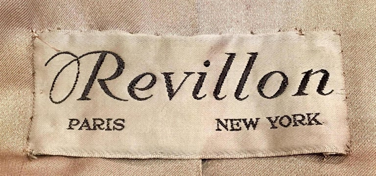Sumptuous Siberian lynx full length fur coat by Revillion Paris New York, evokes glamour and style.  Classically tailored with a large shawl collar, hook and eye closures, slash pockets, belt openings and satiny taupe color fabric lining with velvet
