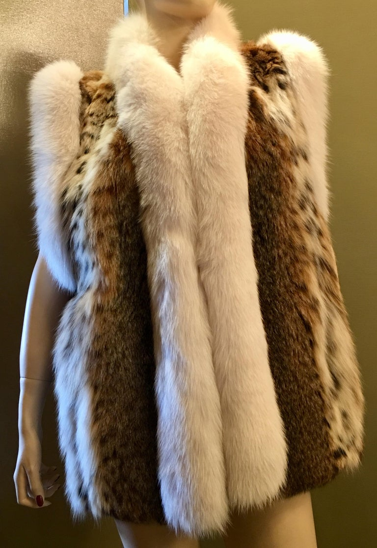 Brown Stunning Luxurious Spotted Lynx Fur Sleeveless Vest with White Fox Fur Trim  For Sale