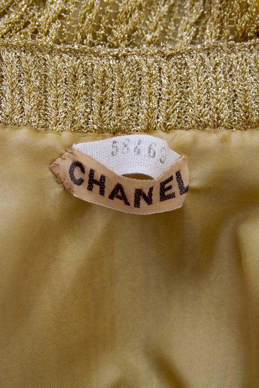 A stunning 1960s Chanel haute couture gold lurex cardigan with long tapered sleeves with three button detail at the cuff. The cardigan has a button down front and two small patch pockets situated on each side of the hip. All buttons features small
