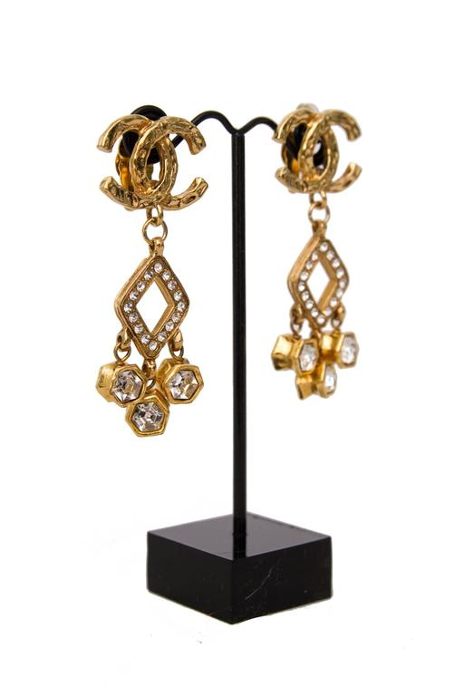 A Pair of 1980s Chanel Gold Toned Dangle Earrings W. Rhine Stone Embellishment 4