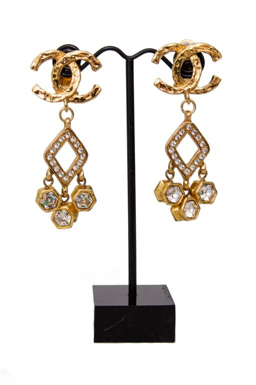 A Pair of 1980s Chanel Gold Toned Dangle Earrings W. Rhine Stone Embellishment 2