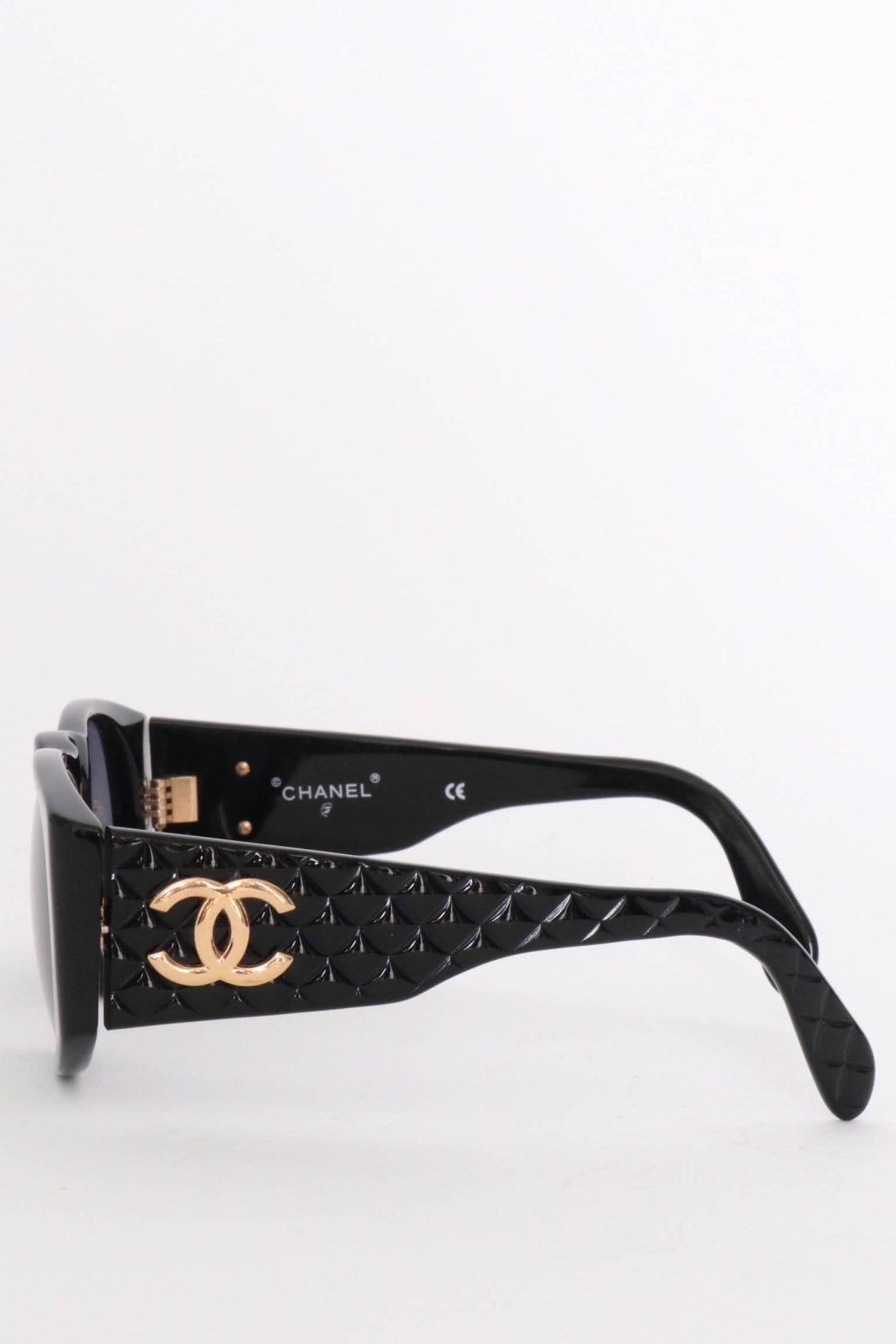 3905fa39ce321 Chanel Sunglasses with Quilted Sides and Gold Toned Logo