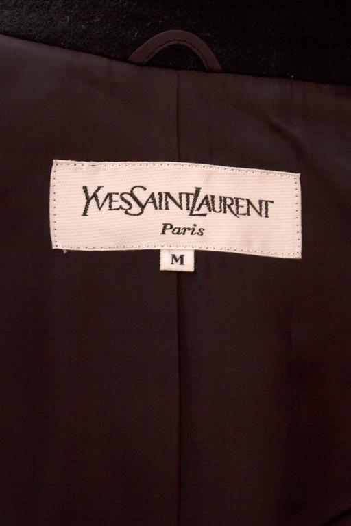 A 1980s black Yves Saint Laurent wool coat with a wide off-white panel down the front. 