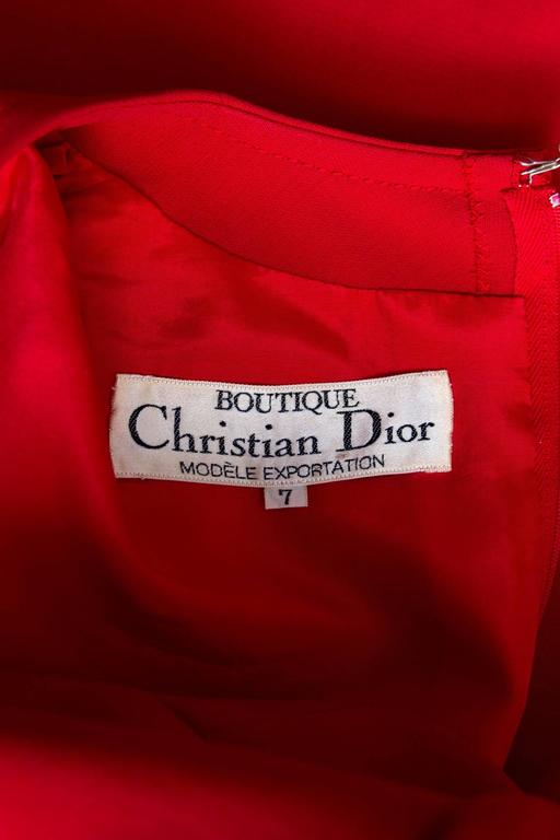 A stunning 1960s Christian Dior bright red a-line wool dress with long tapered sleeves and a round neckline. The little red dress features panel detailing down the from and has two small patch pockets situated on the bust area. The dress is fully