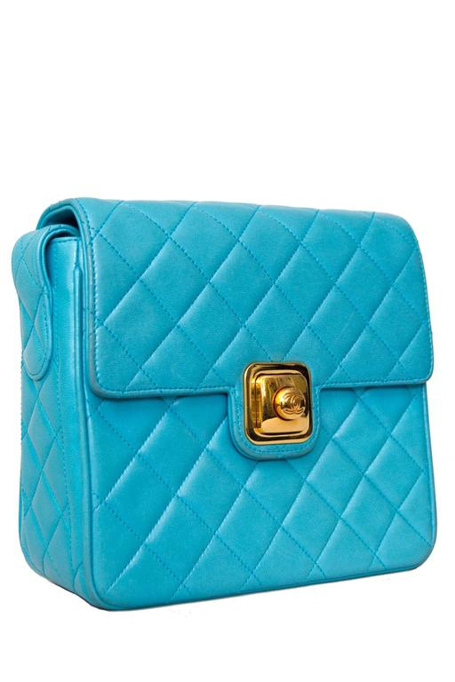 A boxy 90s bright turquoise quilted Chanel leather shoulder bag with gold hardware. 