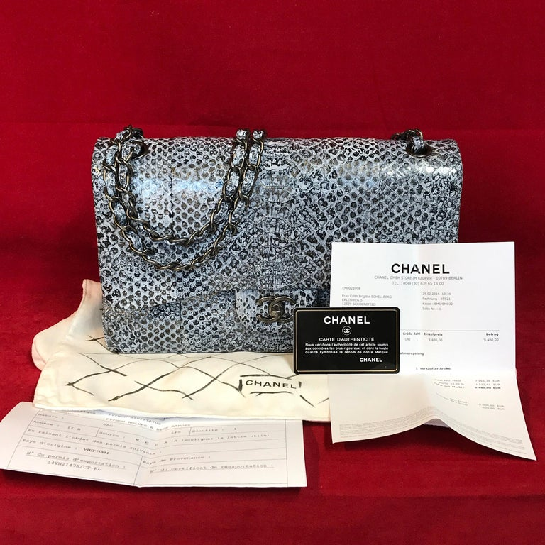 1cdbe6be08569d Extremely rare CHANEL double flap Bag Jumbo made of python leather. The bag  is brand