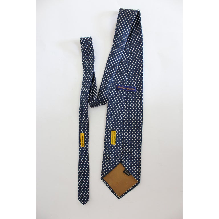 Handmade vintage tie Yves Saint Laurent, blue with white polka dots, 100% silk. Made in Italy. Excellent vintage conditions.  Length: 144 cm Width: 10 cm