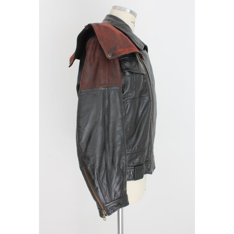 Emporio Armani vintage men's jacket, biker model, black, 100% leather, 1980s. The jacket has burgundy leather inserts and applied studs. Made in Italy. Very good vintage condition. Size: 52 It 42 Us 42 Uk Shoulder: 52 cm Bust / Chest: 58 cm Sleeve: