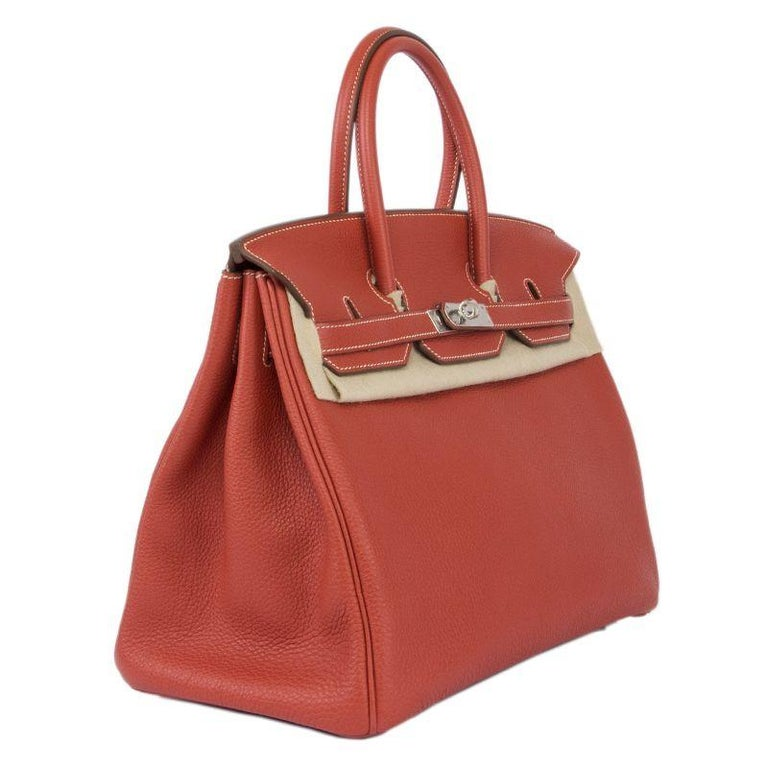Hermes 'Birkin 35' in Sanguine (red) Veau Togo leather. Lined in Chevre (goat skin) with an open pcoket against the front and a zipper pocket against the back. Brand new. Comes with keys, lock, clochette, dust bag, box and rain kit.  Height 35cm