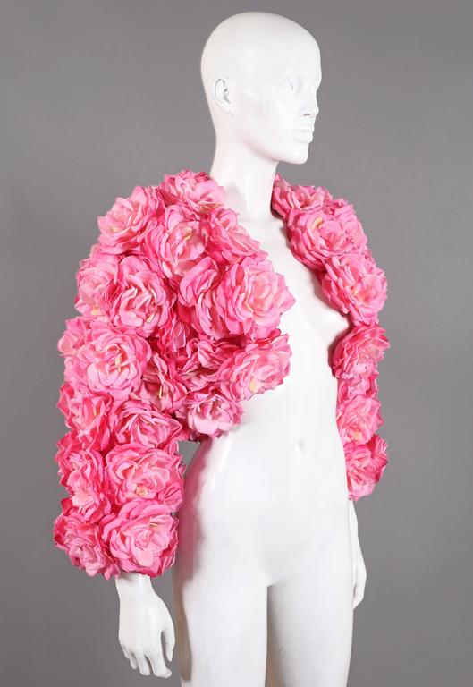 Out of this world oversized bolero jacket by Rachel London. The jacket is adorned in beautiful high quality real touch pink roses which look and feel like real petals! Madonna chose to wear the same design at the Tony Awards in 1988.  Size Small