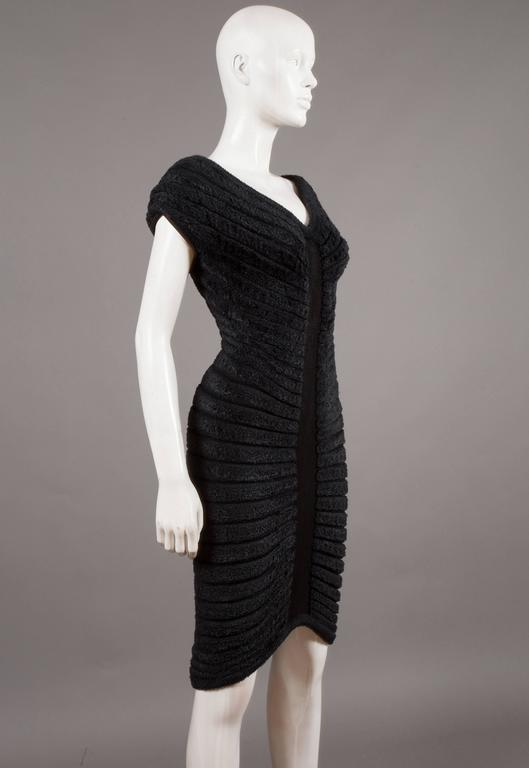 Iconic and rare Alaia black chenille-knitted evening dress, spring-summer, 1994.   Sculpted and figure-hugging with radiating concentric chenille bands.