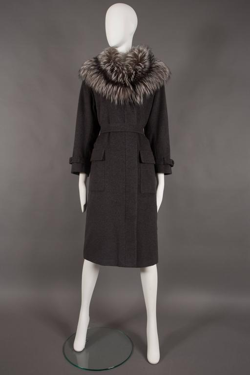 Black Yves Saint Laurent cashmere fall coat with fox fur collar, circa 1990 For Sale