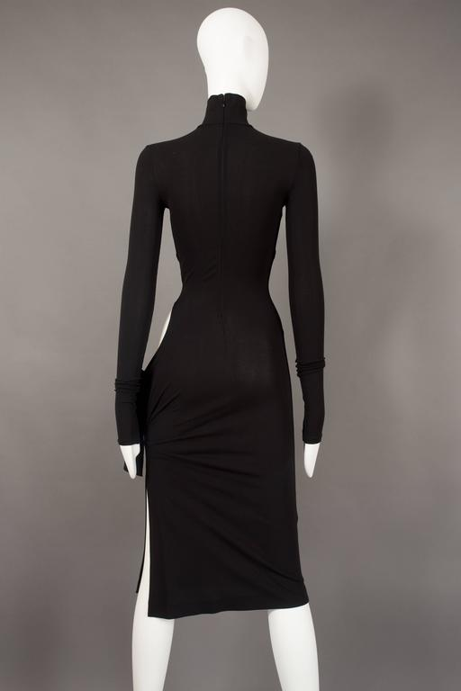 Dolce & Gabbana black bodycon evening dress with cut out, circa 2001 For Sale 1