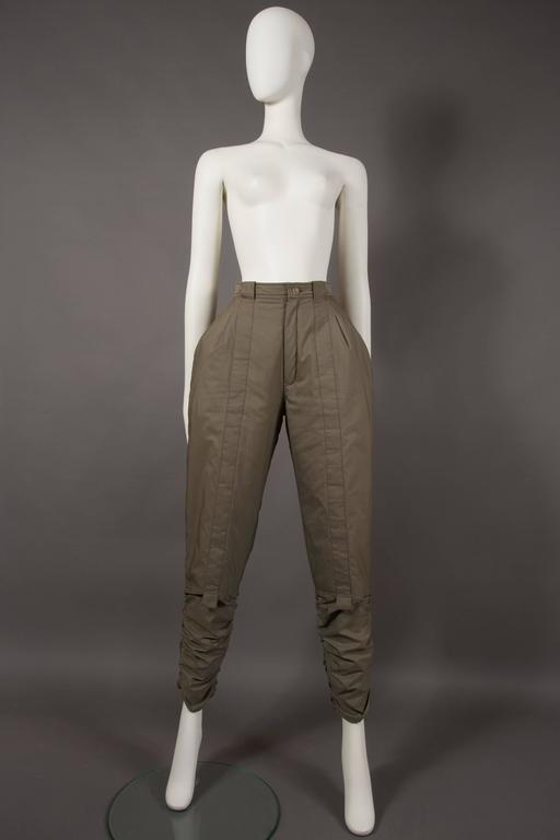 A rare pair of Issey Miyake sports pants, autumn-winter 1983. Ruching on the ankles, high waisted, accentuated hips, two front pockets, two back pockets and zip closure.