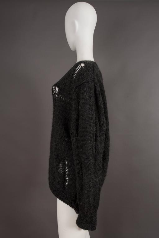 Women's or Men's Comme des Garcons oversized sweater decorated with holes, circa 1982 For Sale