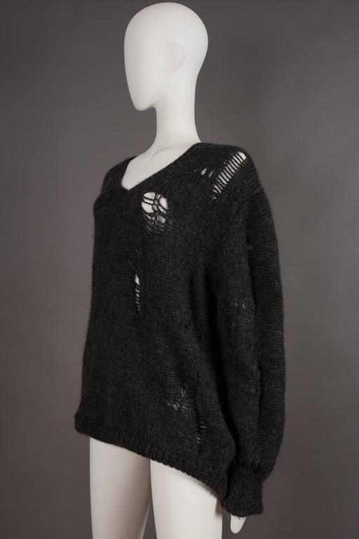 Comme des Garcons oversized sweater decorated with holes, circa 1982 For Sale 1