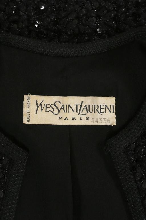 Haute Couture Yves Saint Laurent evening jacket, autumn-winter 1978.  Black sequins throughout, silk lining and one hook-and-eye closure at the collar.