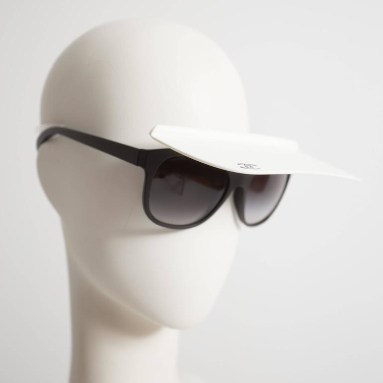 Rare Karl Lagerfeld for Chanel visor sunglasses, spring-summer 2014. Feature attached white visor with 'CC' logo and original case.