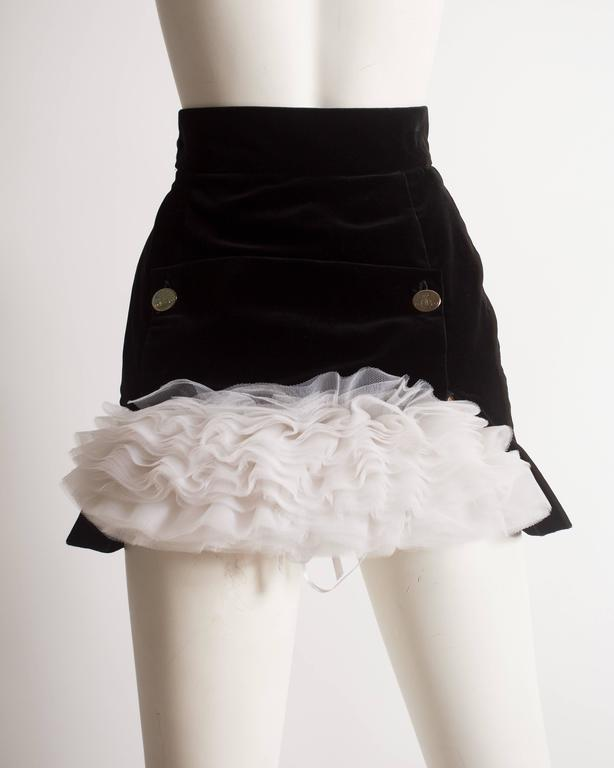 Important Vivienne Westwood black velvet mini skirt with white tulle crinoline at the rear with broderie anglaise trim.   Autumn-Winter 1991