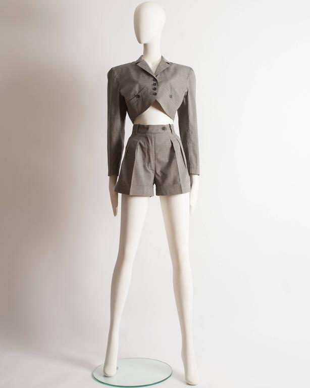 Alaia suit constructed in cotton, spring-summer 1988. High waisted mini shorts and boxy cropped blazer jacket with button closure.