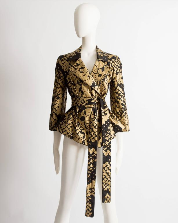 Yves Saint Laurent by Stefano Pilati black evening jacket with gold abstract print and extra long waist belt.