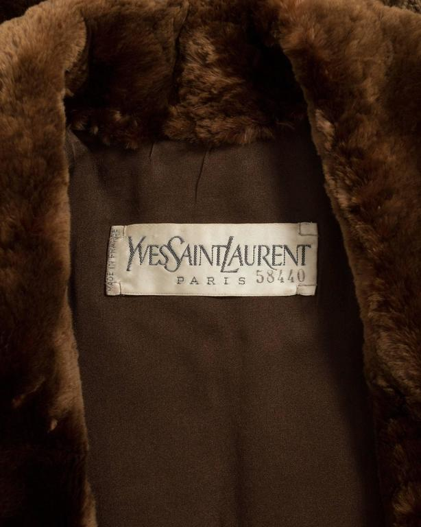 Exquisite Yves Saint Laurent double breasted sheared beaver fur coat from the Autumn-Winter 1985 Haute Couture collection.   The fur is extremely soft and very similar to Chinchilla. Structured padded shoulders, 100% silk lining, two front