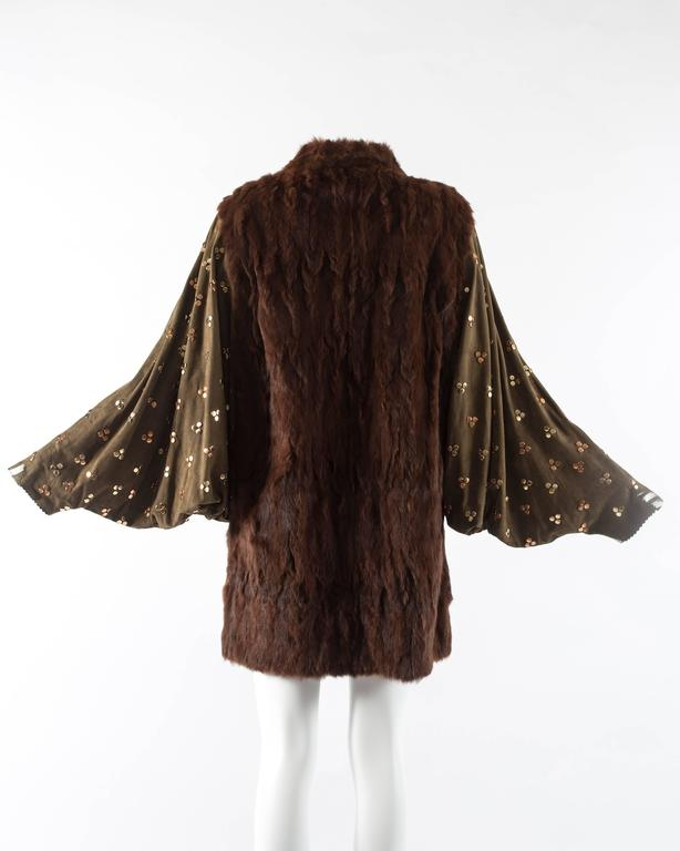 Chloe mink fur coat with studded suede batwing sleeves, circa 1980s. Open design with no closures, metallic silver paint on the cuffs and inside, and slits on the side.