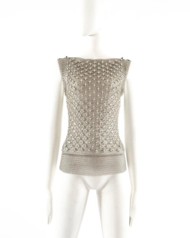 Paco Rabanne silver metal chainmail vest   - four metal clasp closures on the shoulders - over 400 studded Sawrovski crystals on the front
