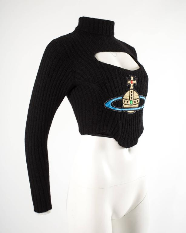 Vivienne Westwood Autumn-Winter 1991 knitted corset with cut out and large orb 3