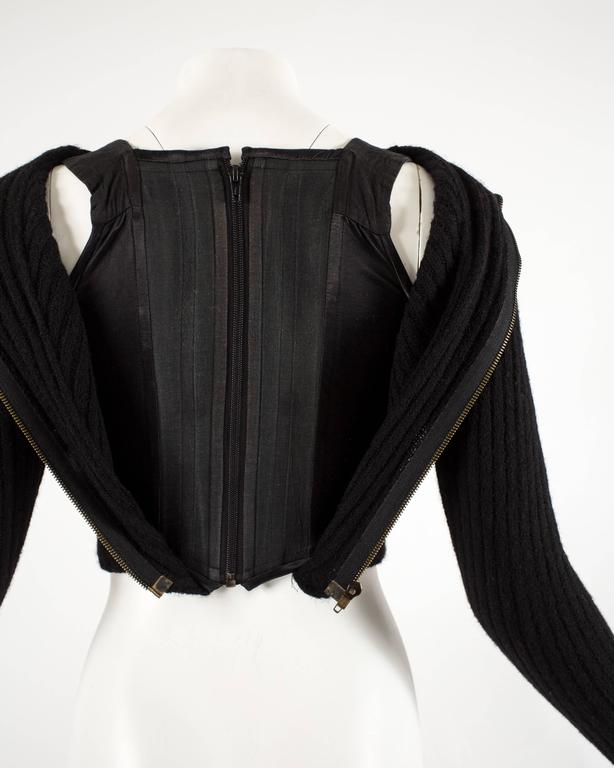 Vivienne Westwood Autumn-Winter 1991 knitted corset with cut out and large orb 5