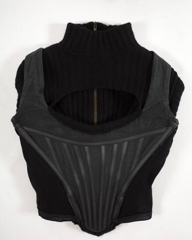 Vivienne Westwood Autumn-Winter 1991 knitted corset with cut out and large orb 6