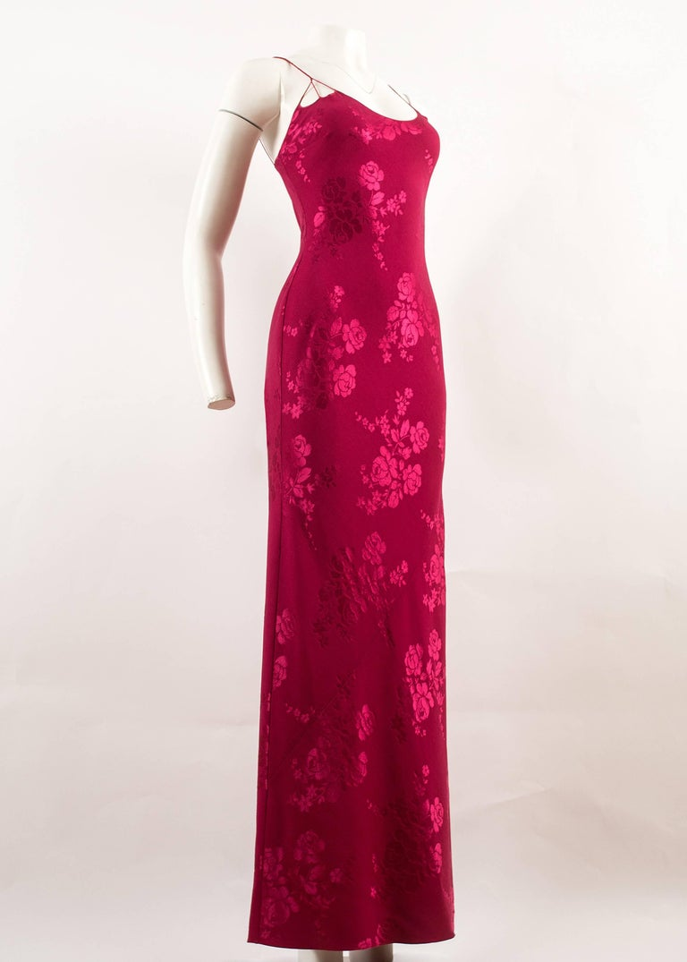John Galliano for Christian Dior 1990s magenta pink bias cut evening dress in a wool and silk blend floral brocade