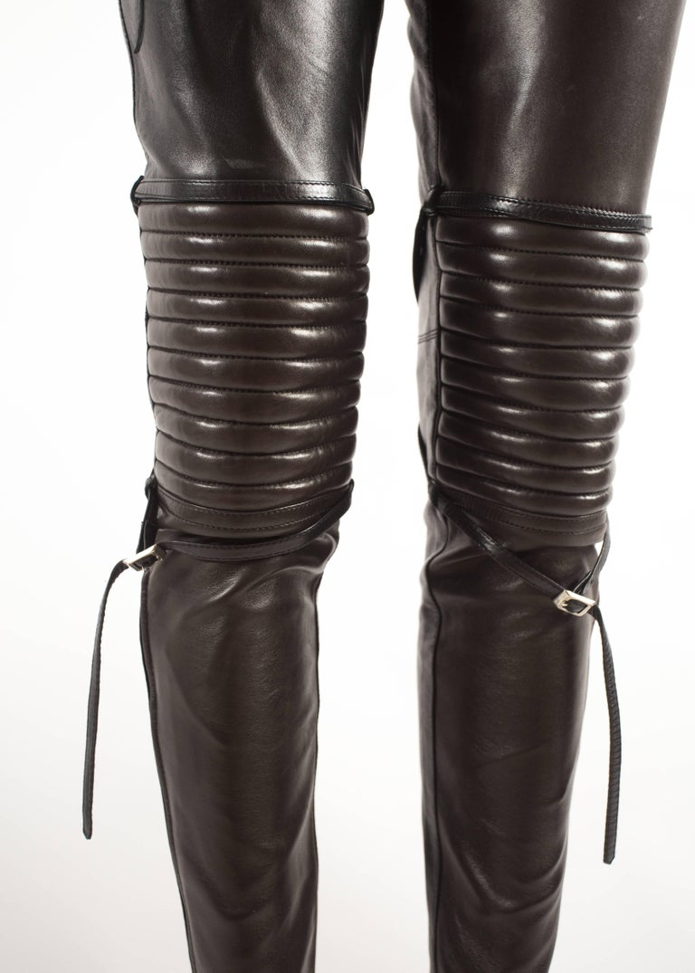 Jean Paul Gaultier Autumn-Winter 1990 black and brown leather biker pants with padding and bondage straps.