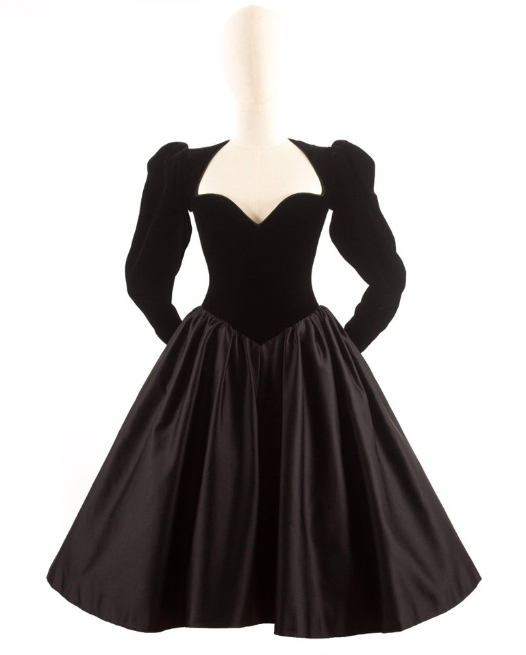 Yves Saint Laurent Haute Couture Autumn-Winter 1981 black velvet cocktail dress with ample pleated skirt of silk satin.