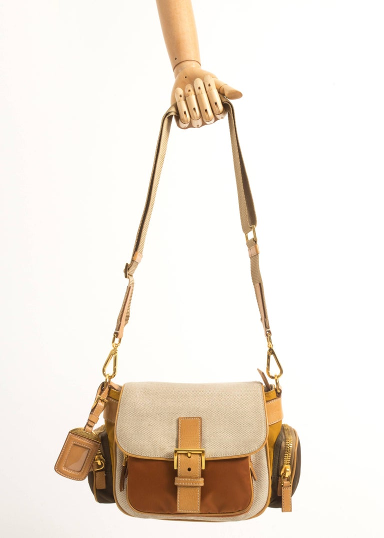 Prada leather, canvas and nylon crossbody bag with adjustable shoulder strap, gold hardware and zip closures