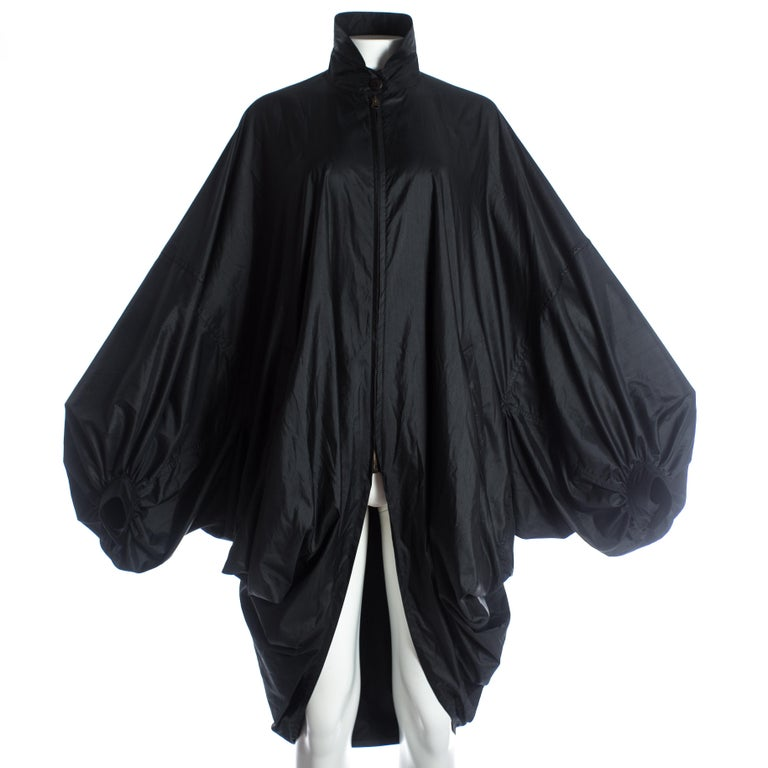 - Circular cut  - Zip fastening  - Standing collar  - Huge draped sleeves with cuffs  - XXL oversized fit  Autumn-Winter 1987