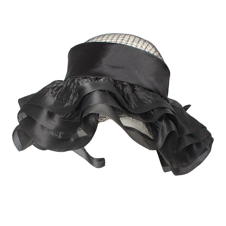 Balenciaga early 1960's black silk and mesh hat with floral embellishment