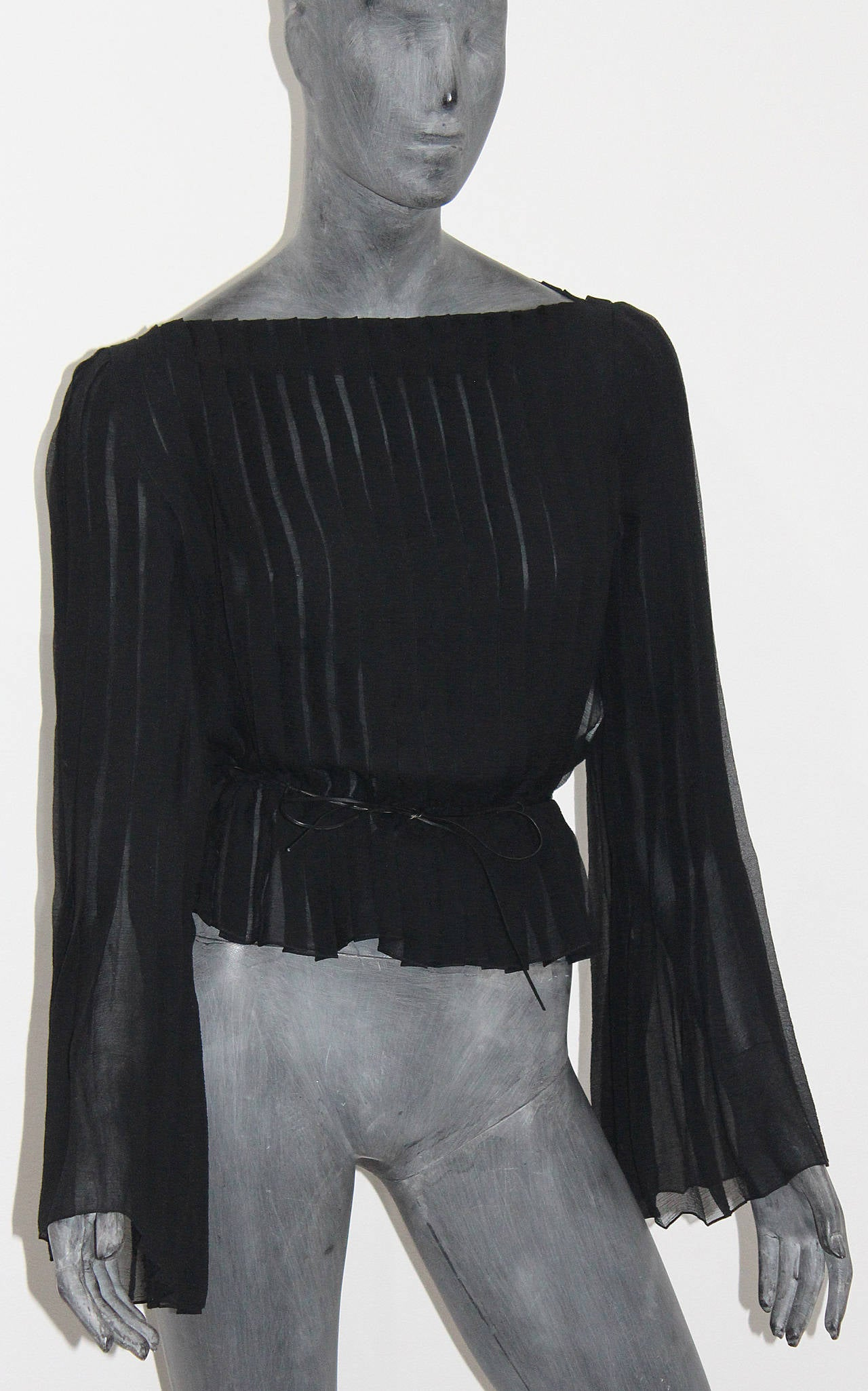 A beautiful black pleated silk chiffon blouse designed by Tom Ford for Gucci. Does not come with belt.