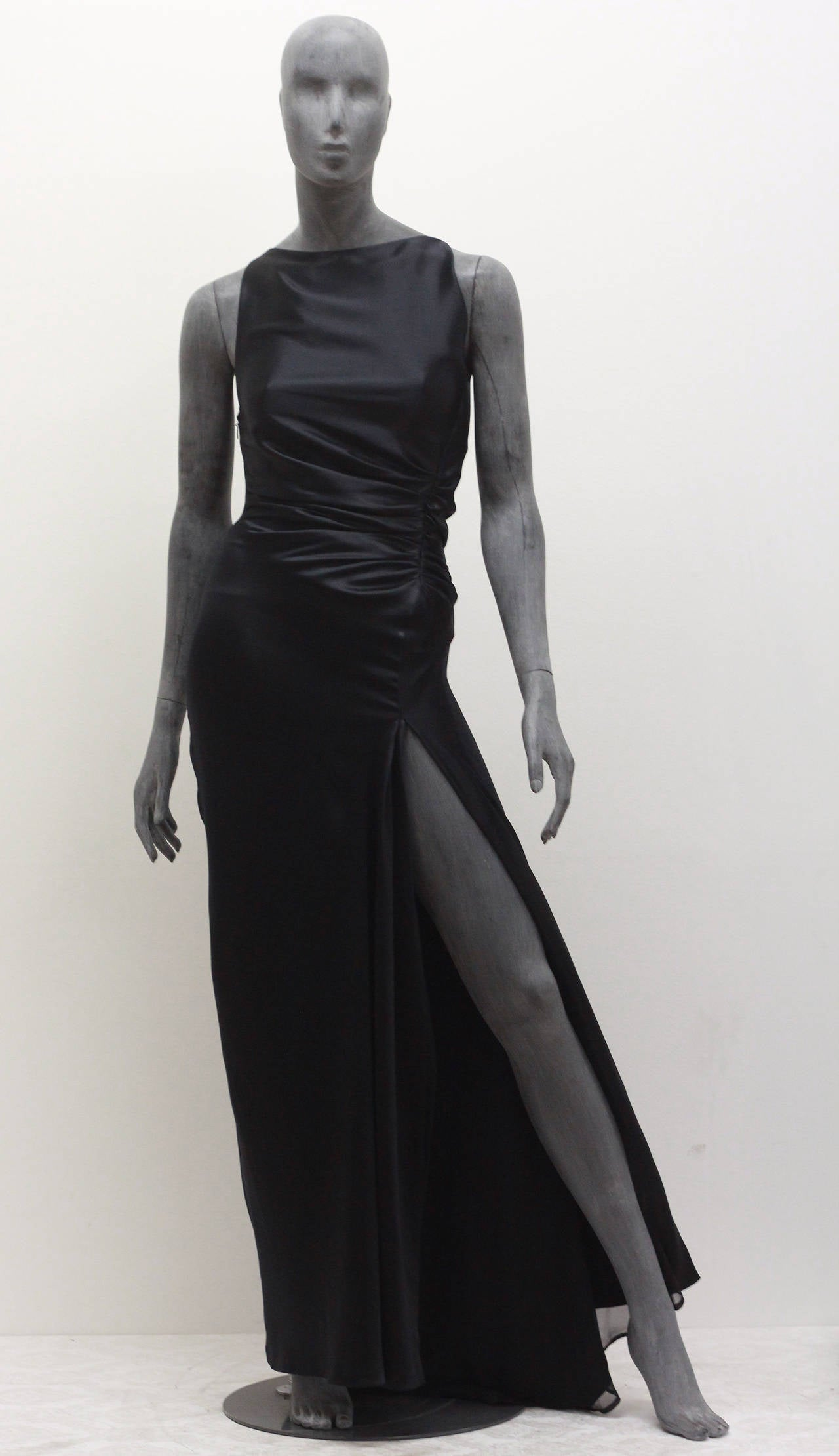 This is a black silk evening dress by Tom Ford for Gucci, the dress features a high leg slit, silk chiffon under layer and pleated bodice. 