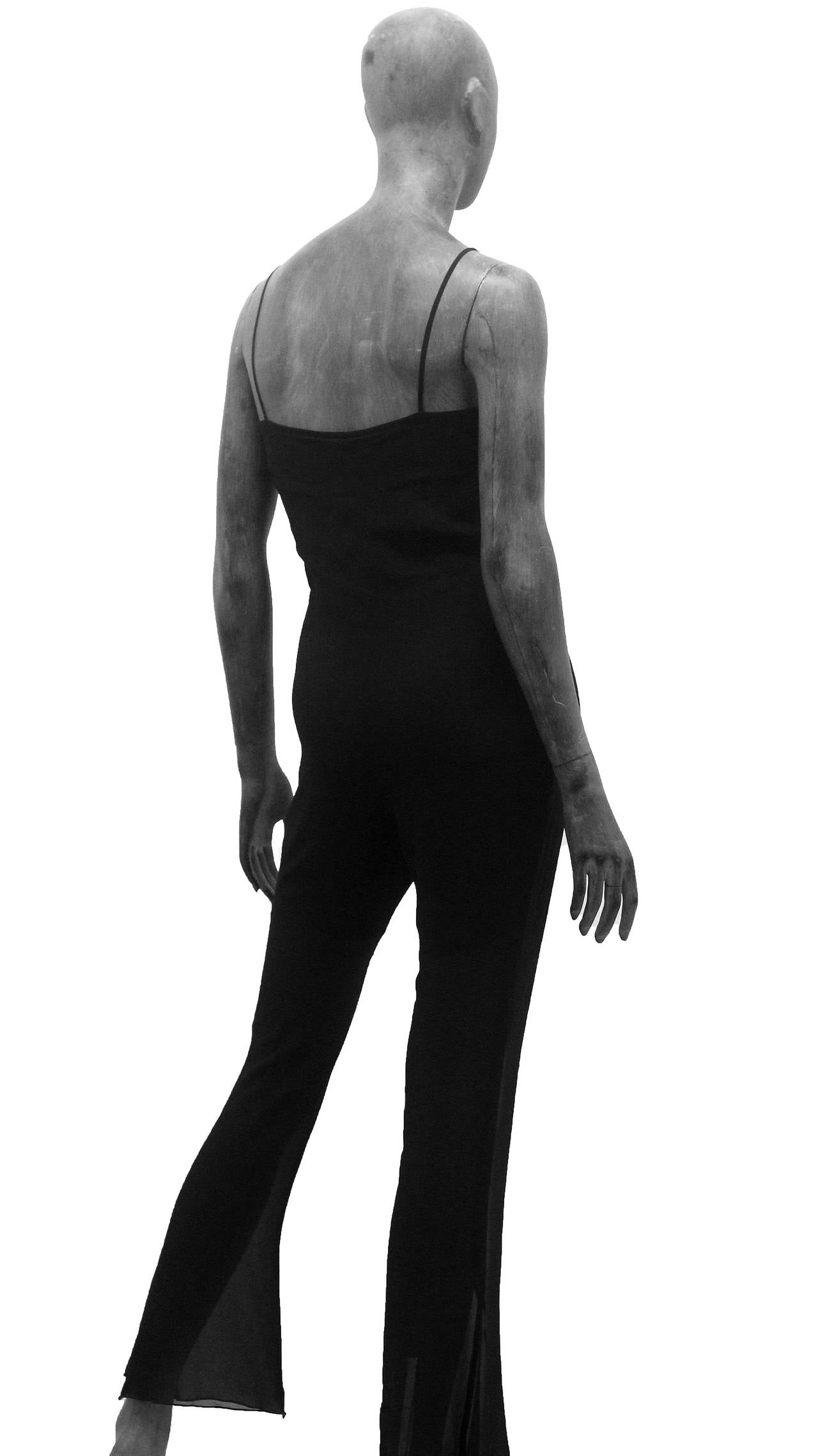A beautiful summer jumpsuit by Chanel designed by Karl Lagerfeld. The jump is in black silk chiffon and features spaghetti straps and flared leg.   Size Fr 36
