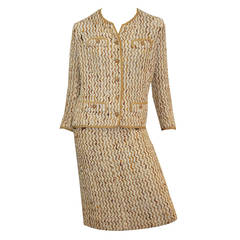 Iconic Couture 1960s CHANEL boucle two-piece suit.