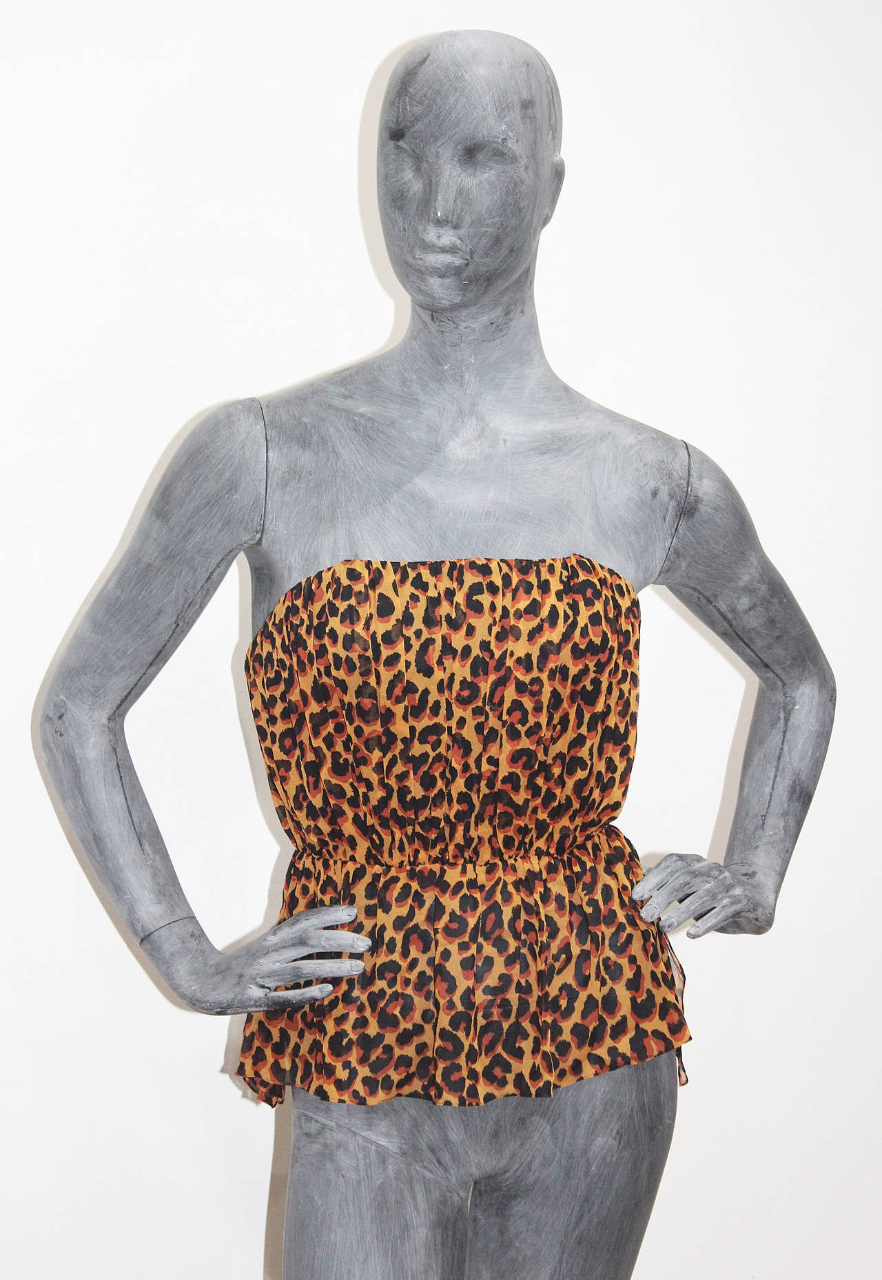 A vintage Yves Saint Laurent boned bustier in a pleated silk chiffon in a leopard print. 
