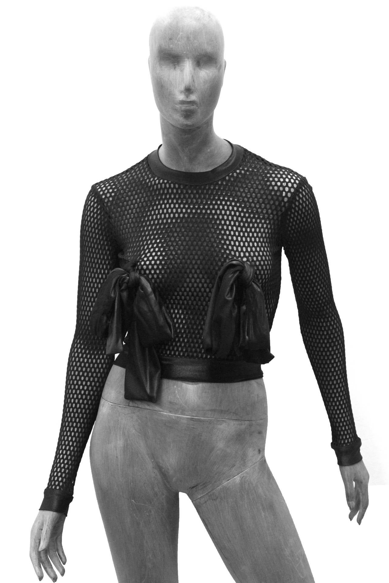A rare black mesh top by Pam Hogg from London design Pam Hog, made in the 1990s.   Size Small