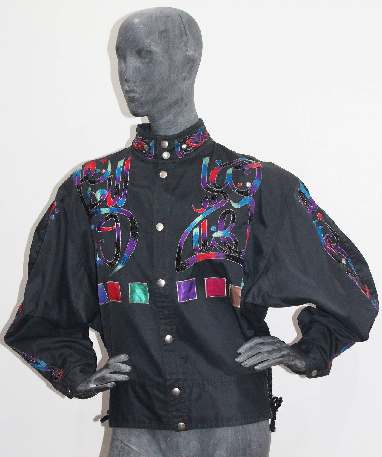 A very rare embroidered Buddha black cotton bomber jacket by Kansai Yamamoto. The features lace up sides, metal thread and multi coloured embroidery.   Medium  Kansai Yamamoto is known for his highly conceptual and innovative designs in the 70s