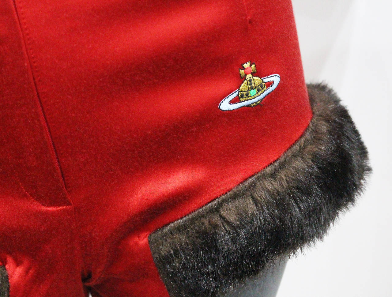 Very rare Vivienne Westwood 90s hot pants in red satin with brown faux fur trim. 