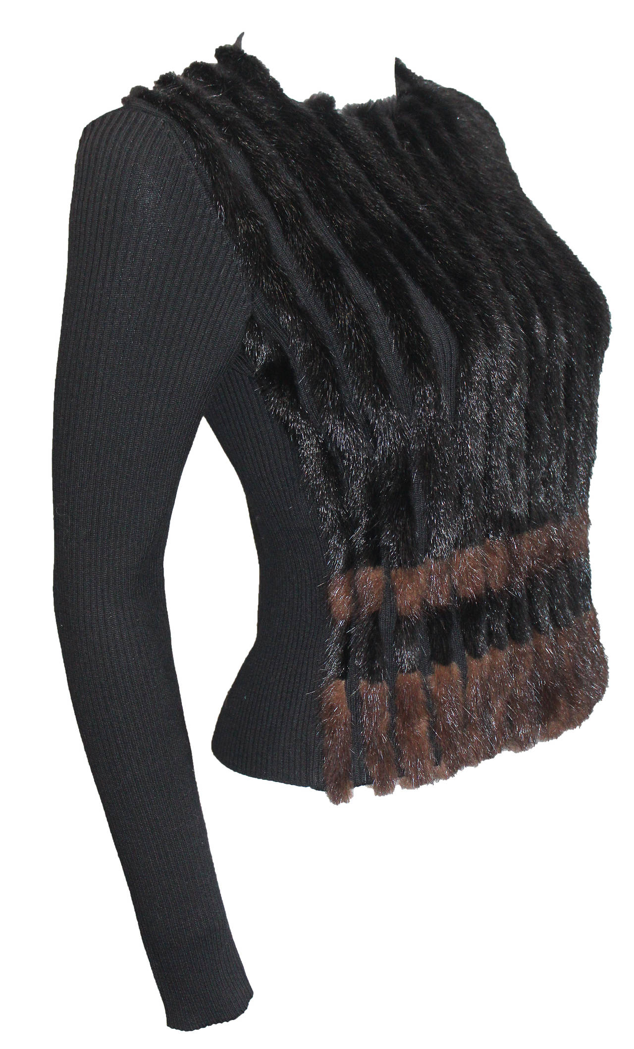 A rib knit sweater by Prada from the 1990s with mink fur striped panels.   Sizing: It 38 / Fr 34 / UK 6 / US 4