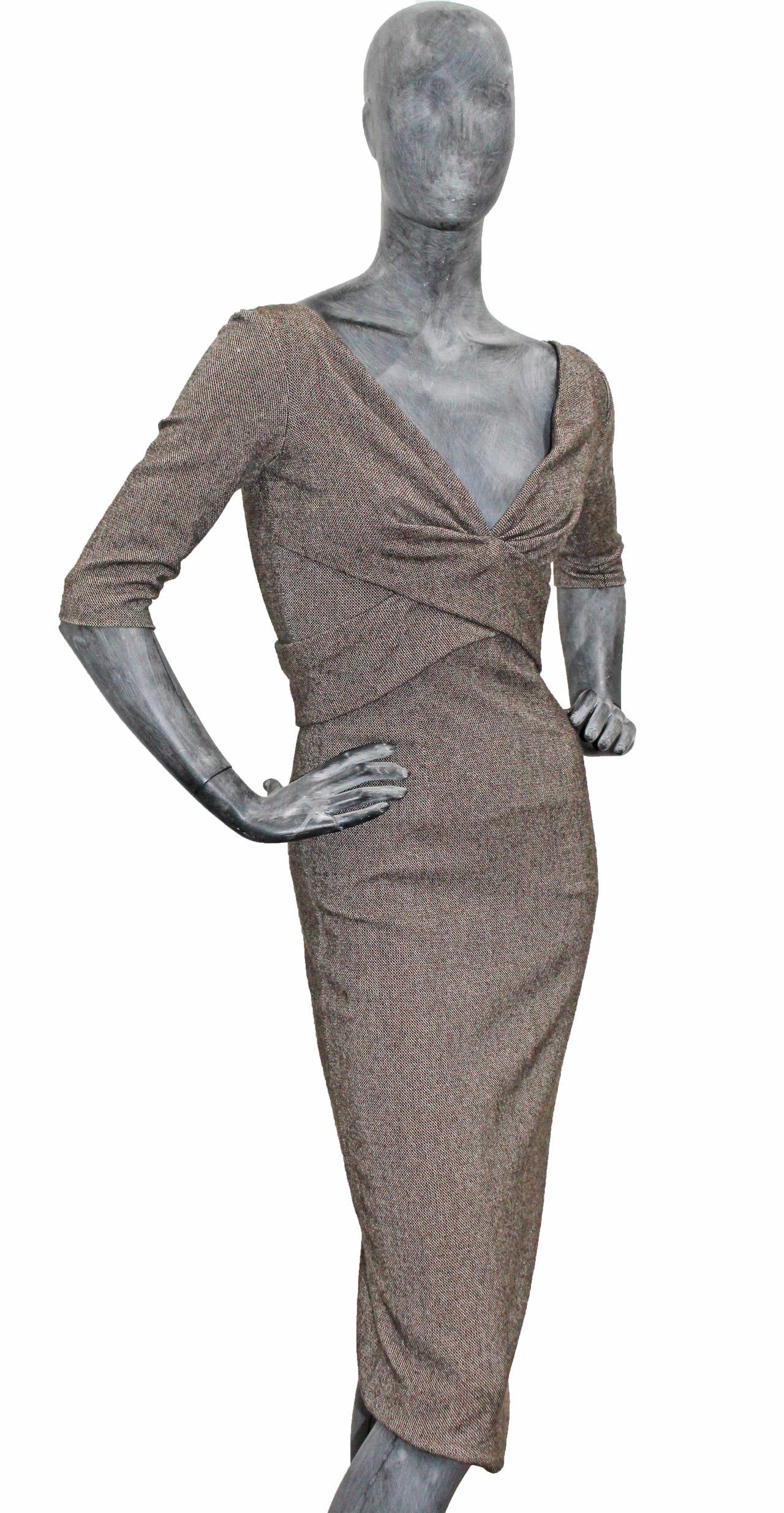 Tweed dress designed by Alexander McQueen in a 1950s pin-up style from the Autumn/Winter 2005 runway collection. 
