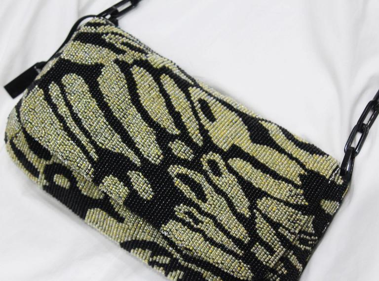 A Tom Ford for Gucci beaded evening bag from the Spring/Summer 2000 season. The bag has a linked chain shoulder strap and black silk lining.