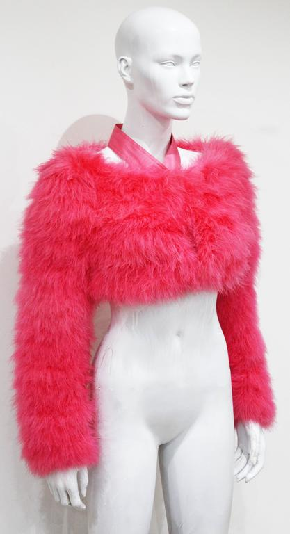 A marabou fur bolero in hot pink from the Spring/Summer 2004 runway collection. The bolero was designed by Tom Ford for Gucci. 100% silk halter neck design and lining. 
